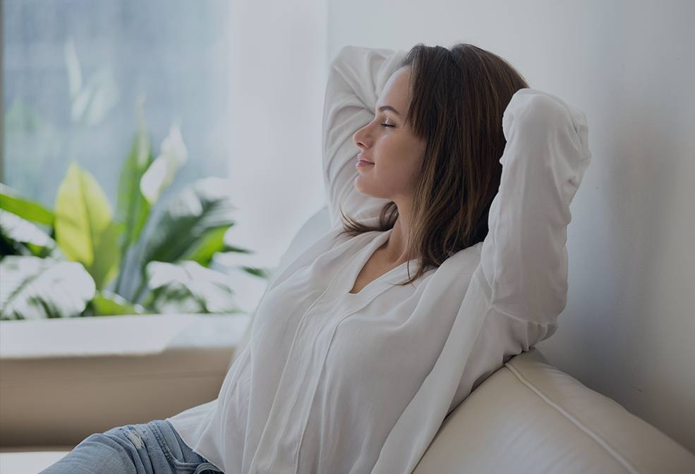 Woman relaxing after oral conscious sedation dentistry visit