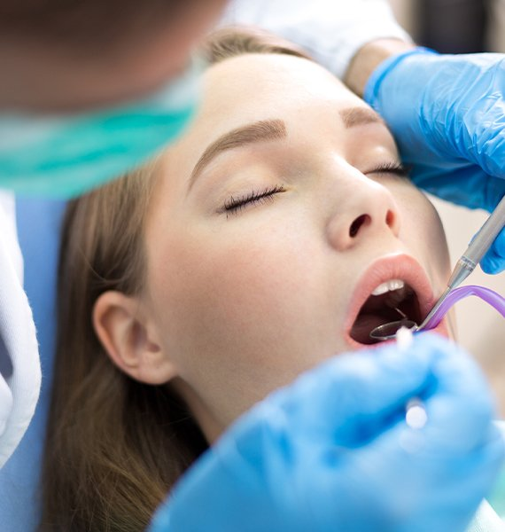 Woman receiving treatment under oral conscious dental sedation